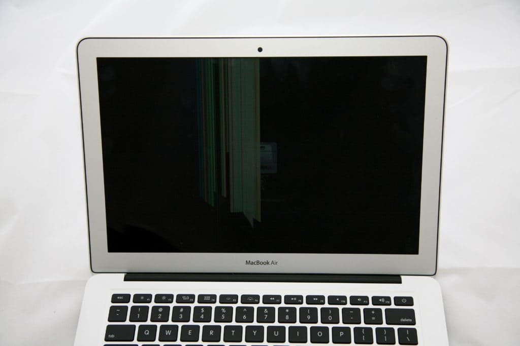 MacBook Air Screen Damage example. The left side of the screen obscured by damage.