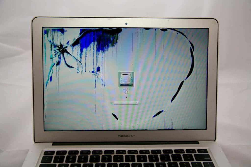 MacBook Air with crack on top left and blue discoloration immolating from center of damage