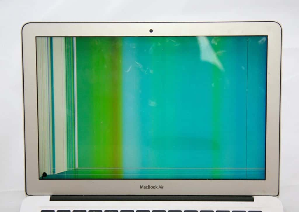 13 inch MacBook Air with blue and green hue from LCD damage.