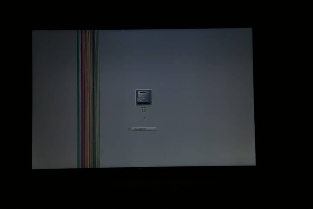 MacBook with bar of lines on the display