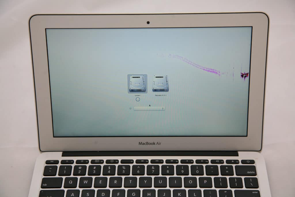 MacBook Air with hairline crack starting from impact point